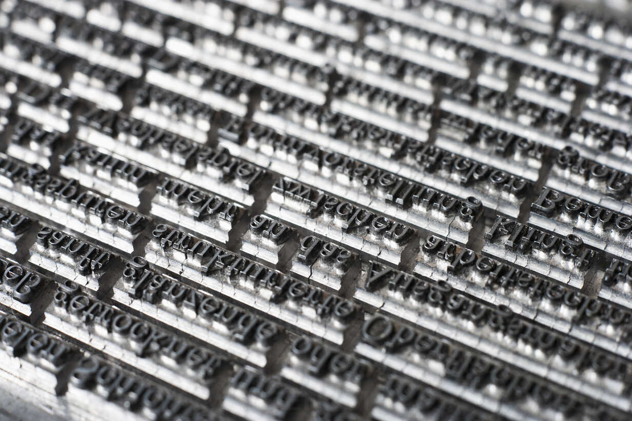 Germany, Bavaria, Continous text of typesetting in shop, close up - TCF003366 - Tom Chance/Westend61
