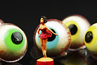 Dancing figurine in casting situation with candy eyeballs in background - HOHF000076