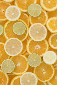 Slices of orange, lemon and lime, close up - ASF004860