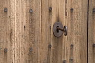 Germany, Wooden door with key in keyhole, close up - ASF004861