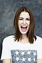 Portrait of young woman shouting - SPOF000060