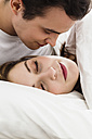 Young man looking at young woman while sleeping - SPOF000078