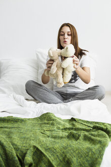 Young woman playing with teddy bear - SPOF000090