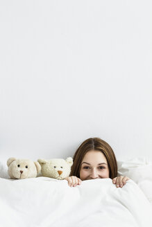 Young woman playing with teddy bear - SPOF000092