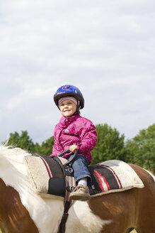 Germany, Girl riding horse, smiling - JFE000046