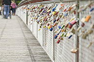 Germany, Bavaria, Munich, Love locks with backgrounds people - CRF002336