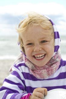Denmark, Girl at beach, smiling - JFE000072