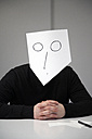 Man covering face with mask - TKF000057