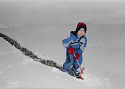 Austria, Boy removing snow with snow shovel - CWF000017