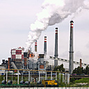Spain, Avila, Steelworks with smoking industrial chimneys - BSC000243