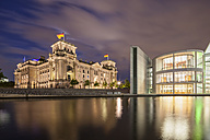 Germany, Berlin, View of Reichstag dome and Paul Loebe Haus at night - FOF005032