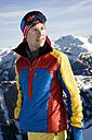 Austria, Man looking away, smiling - RN001166