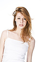 Portrait of young woman against white background, close up - MAEF006143