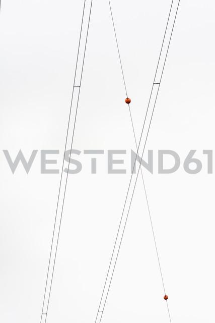 Germany, North Rhine Westphalia, Power lines against sky - HLF000105