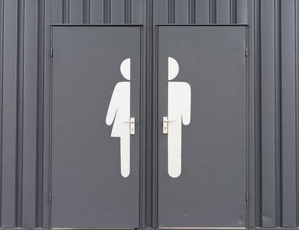 Germany, Male and female sign on toilet door - HLF000109