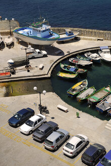 Malta, Parked cars and fishing boats in harbour - MIZ000234