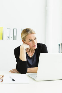 Germany, Businesswoman looking at laptop - SPO000202