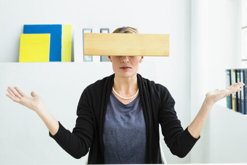 Germany, Wood covering eyes of businesswoman - SPO000207
