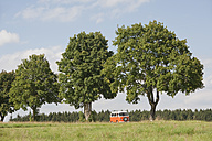 Germany, Bavaria, Camping bus on landscaped meadow - CR002347