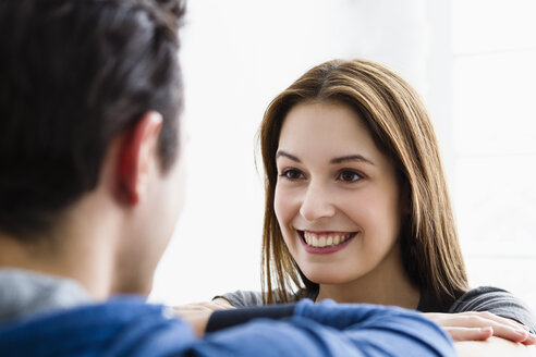 Germany, Munich, Young couple looking at each other, smiling - SPOF000267