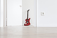 Guitar leaning on wall - FMKF000524