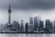 China, Shanghai, Financial District with dramatic sky - FL000310