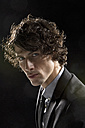 Portrait of man against black background, close up - MAE006264