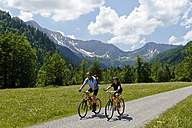 Germany, Bavaria, Mature man with boy cycling - LB000098