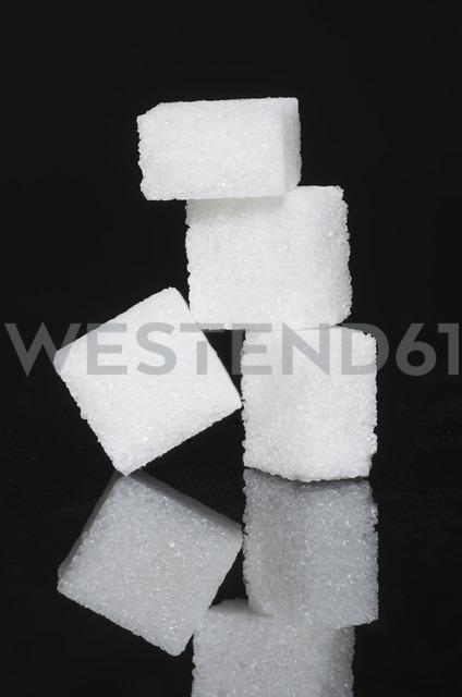 Stack of sugar cubes on black background - MU001300