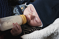 Germany, Hesse, Frankfurt, Baby boy drinking milk, eyes closed - MUF001277