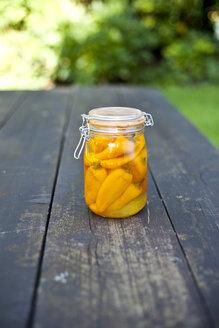 Germany, Duesseldorf, Yellow paprikas pickle in glass of jar - KVF000016