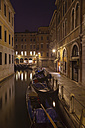 Italy, Venice, Gondalas on little canal near St Mark's Square at night - HSIF000262