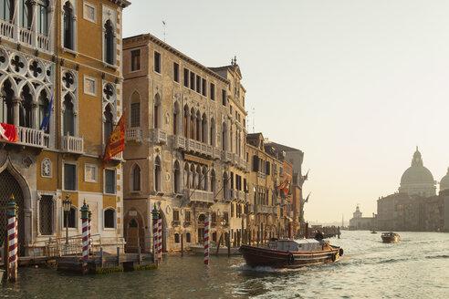 Italy, Venice, Morning deliveries on Canal Grande at Santa Grande della Salute - HSI000268