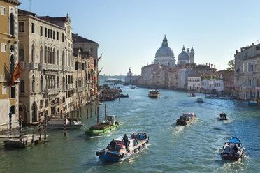 Italy, Venice, Morning traffic on Grand Canal at Santa Maria della Salute church - HSI000161