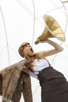 Germany, Paderborn, Woman shouting into Gramophone funnel - AJF000005
