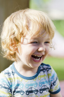 Austria, Boy laughing and looking away, close up - LF000511