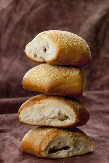 Stack of ciabatta rolls on textile, close up - CSF018303
