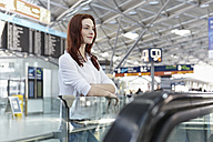 Germany, Cologne, Young woman at airport - RHYF000345