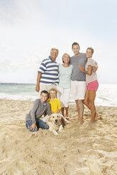 Spain, Portrait of family on beach at Palma de Mallorca, smiling - SKF001242