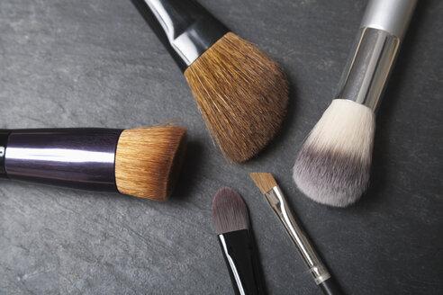 Make up brushes on slate board, close up - TDF000005