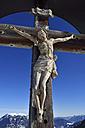 Germany, Bavaria, Carved wooden Jesus crucifix on Kreuzeck Mountain - ESF000370