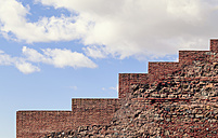 Spain, Malaga, View of red brick wall infront of blue sky - WVF000328