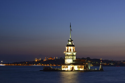 Turkey, Istanbul, View of Maidens Tower and Hagia Sophia at dusk - LH000010