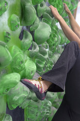 Germany, Bavaria, Munich, Young woman bouldering - HSIYF000166