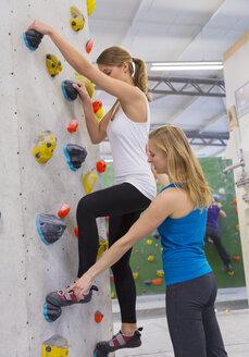 Germany, Bavaria, Munich, Climber teaching woman to climb - HSIYF000203