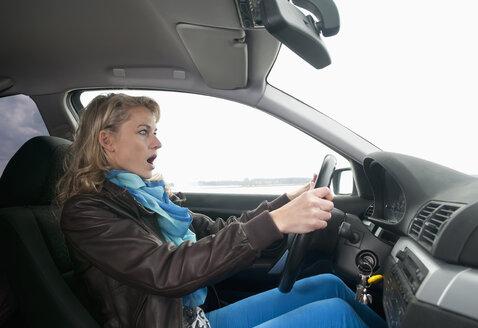Germany, Brandenburg, Shocked  woman in car - BFRF000221