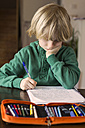 Germany, Bavaria, Landshut, Boy doing his schoolwork - SARF000007