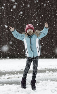 Austria, Girl jumping in snow - CWF000033