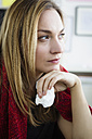Germany, Bavaria, Munich, Young woman looking away, close up - SPOF000330