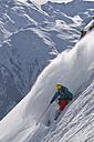 Austria, Man skiing on snowcapped mountains - FF001333